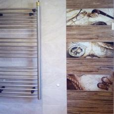 Лепене на плочки и декоративни пана в баня